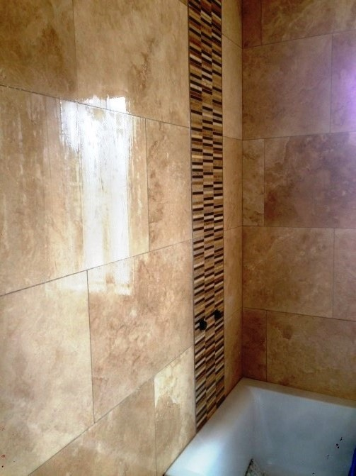 Travertine Bathroom Wall Tiles Refinished Following Installation