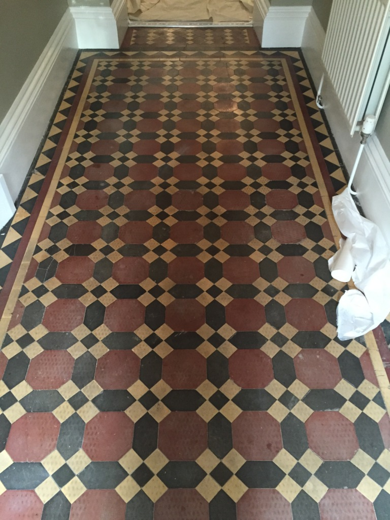 Victorian hallway floor tiles before restoration in Bridlington